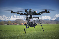 Camera Drone. Big professional camera drone in mid-air royalty free stock images