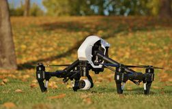 Camera Drone (Fall Colors & Leaves in Background). Camera drone at the park Royalty Free Stock Image