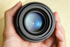 Camera dslr lens with hand holding Stock Photos