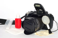 Camera and easy cleaning supplies. With Brush and Blowing ball and Cleaning solution and Cotton swabs Royalty Free Stock Image