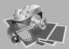 Camera en film tegen de achtergrond van de foto's Stock Foto's