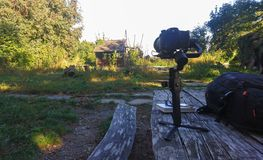 Camera equipment and gimbal setup on outdoor bench. royalty free stock images