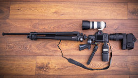 Camera equipment in the shape of machine gun Royalty Free Stock Images