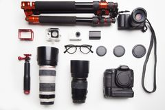 Camera equipment. On top of white table view from top Stock Image