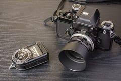 Camera and exposure meter Royalty Free Stock Image