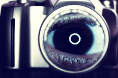 Camera and eye. Abstract eye in camera lens- ink saturated conceptual background Stock Image