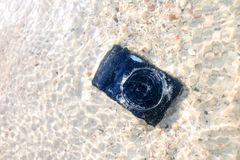 The Camera fall to the sea water. Stock Image