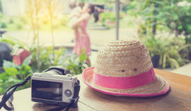 Camera and Farm hat travel with family memories background. Camera and Farm hat travel with family memories vintage background Stock Photos