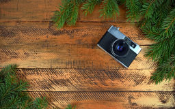 Camera on a festive background. Christmas. Technologies. Stock Images
