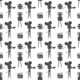 Camera, film reel and clapperboard, vintage seamless pattern, handdrawn sketch, retro movie industry, vector illustration Stock Photos