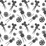 Camera and film reel vintage seamless pattern, handdrawn sketch, retro movie industry, vector illustration Royalty Free Stock Photos