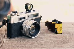 Camera film. Retro vintage classic camera film on wood background royalty free stock photography