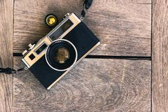 Camera film. Retro vintage classic camera film on wood background Royalty Free Stock Image