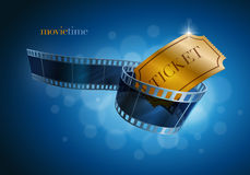 Camera film strip and gold ticket. Royalty Free Stock Images