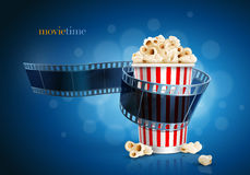 Camera film strip and popcorn. Camera film strip and popcorn on blue defocus background. Detailed vector illustration. Elements are layered separately in vector Royalty Free Stock Images