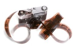 Camera and filmstrip. Range-finder camera and strip of 35mm negative film isolated on white Royalty Free Stock Image