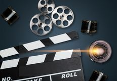 Camera and filmstrip on table. Movie camera cinematography concept creative lens stock photos