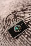 Camera on a fingerprint. Concept: A camera is on a thumbprint which represents the police fingerprinting a lawbreakers and photographine a crime scene Stock Images