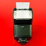 Flashgun. A closeup of a camera flashgun  with reflector Stock Image