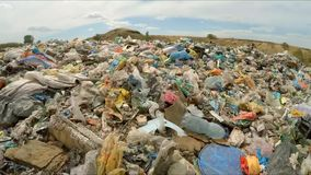 A large amount of garbage in the city dump. bird`s-eye view. The camera flies over a large amount of debris in a city dump. the camera takes a bird`s-eye view stock footage