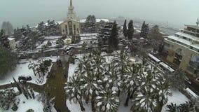 Camera flies over a mountain lake stock video
