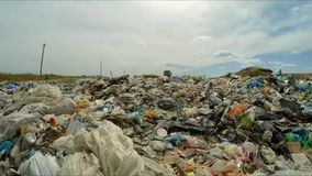 Piles of garbage in the city dump. bird`s-eye view. The camera flies over a pile of garbage in a city dump. the camera takes a bird`s-eye view stock video footage