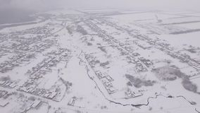 The camera flies over the snow-covered city in Russia stock footage