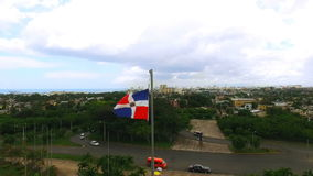 The camera flies past a waving flag of the Dominican Republic stock video footage