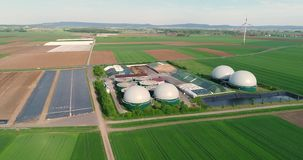 Camera flight over biogas plant from pig farm. Renewable energy from biomass. Modern agriculture European Union. aerial. View, panoramic view from the air stock video
