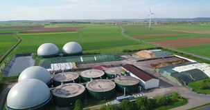 Aerial video of Biogas plant, alternative energy sources, renewable energy. Camera flight over biogas plant from pig farm. Renewable energy from biomass. Modern stock video footage