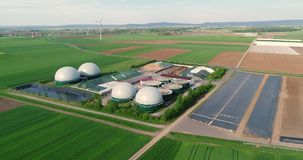 Camera flight over biogas plant from pig farm. Renewable energy from biomass. Modern agriculture European Union. aerial. View, panoramic view from the air stock footage