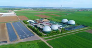 Camera flight over biogas plant from pig farm. Renewable energy from biomass. Modern agriculture European Union. Aerial view, panoramic view from the air stock footage