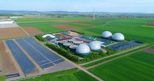 Camera flight over biogas plant from pig farm. Renewable energy from biomass. Modern agriculture European Union. Aerial view, panoramic view from the air stock video