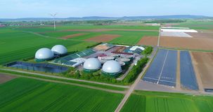 Camera flight over biogas plant from pig farm. Renewable energy from biomass. Modern agriculture European Union. Aerial view, panoramic view from the air stock video footage