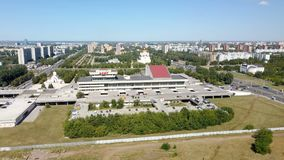 Camera is flying over building of Palace of culture, art and creativity in russian city Togliatti. And showing aero panorama of the city stock video