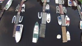 Camera flying over yachting marina stock footage