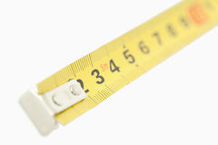 Camera focus on a yellow measuring tape Royalty Free Stock Photography