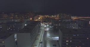 Camera follows cars, on the road at night. Aerial footage. stock footage