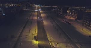 Camera follows cars, on the road at night. Aerial footage. stock video
