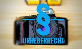 Camera with in german Urheberrecht in english copyright stock images