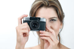 Camera girl. Picture of lovely girl with old rangefinder camera Royalty Free Stock Images