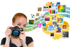 Camera Girl with Photos Popping Out. A woman is holding a camera and looking into a camera while abstract photos are coming out the side of her royalty free stock photography