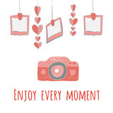 Camera girlnda of hearts and photos.enjoy every moment lettering. Royalty Free Stock Images