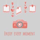 Camera girlnda of hearts and photos.enjoy every moment lettering. Stock Photo