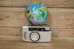 Camera and Globe Royalty Free Stock Photography