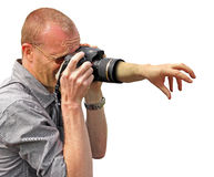 Camera grab hand. Concept photo of a grabbing hand coming from inside a zoom lens as picture is being taken Royalty Free Stock Image