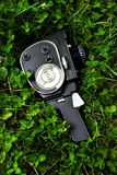 Camera on grass Royalty Free Stock Photo