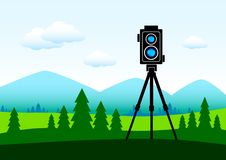 Camera in green landscape Stock Photo