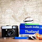Camera and Guide books Stock Photos