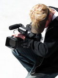 Camera Guy. Local news camera man shooting an event Stock Photos